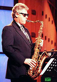 Bill Clinton plays the saxophone.