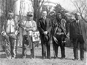 President Calvin Coolidge with four Osage Indians