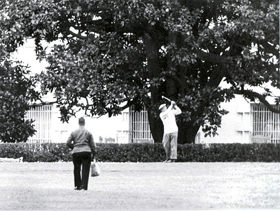 President Eisenhower chipping onto the green around 1957