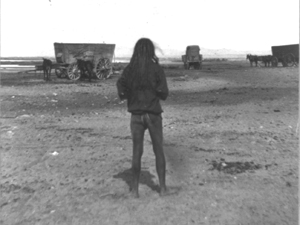 An Arizona Indian watches as Emigrants make their way West
