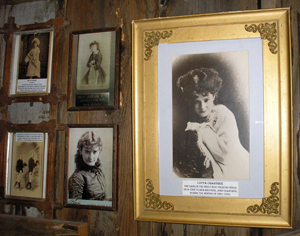 Photos, prints, and paintings of women line the walls of the Bird Cage Theatre