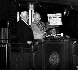 Harry S. Truman holding a copy of the Chicago Tribune proclaiming Dewey the winner.