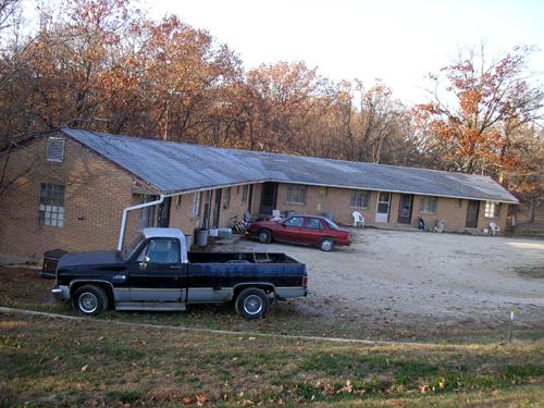 Old motel beyond St. Clair