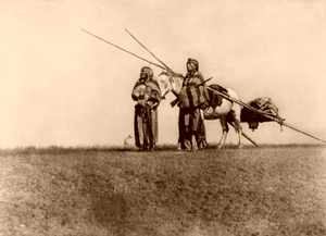 Two Blackfoot men with a travoi