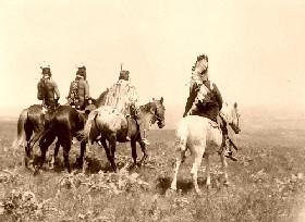 Apsaroke (Crow) braves on horses
