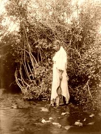 Arikara maiden at the water's edge, 1908