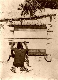 Hopi woman weaving in 1879