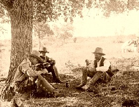 Cowboys relaxing in the shade
