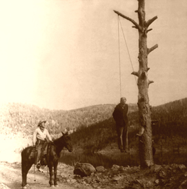 A man is hanged in the Old West.