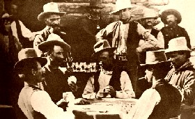 Playing poker at Egan's Saloon in Burns, Oregon , 1882.