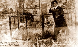 Calamity Jane at Bill Hickok's grave in 1903.