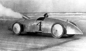 Louis Ross racing in the twin-engined Stanley 'Woogle-Bug' steam automobile - Daytona Beach, Florida 1903