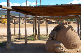 Drying rack and adobe oven at Taos Pueblo