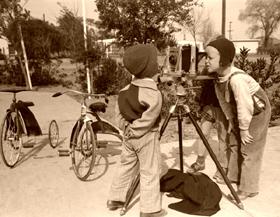 Children inspecting the FSA photographer's camera