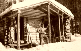 Ranger in front of one of the backcountry cabins.