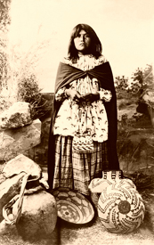 Apache woman with baskets