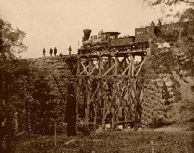 "The engine ""Firefly"" on a trestle of the Orange and Alexandria Railroad"