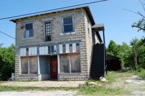An old commercial building stands vacant in Empire City today, Kathy Weiser