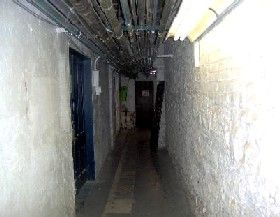 Corridor to the area of the former morgue, when the hotel was used as a Naval Hospital during WWII