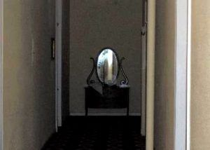 "A rather large ""orb"" can be seen in front of the mirror. The doorway to the left is the entrance to the attic. To the right is room 551"