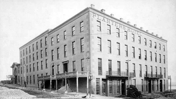 The Planters Hotel was completed in December, 1856, stood at the cornerof Main and Shawnee Streets