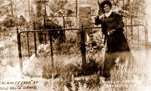 Calamity Jane at Bill Hickok's grave in 1903