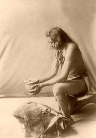 Incense over a medicine bundle, by Edward S. Curtis, 1908