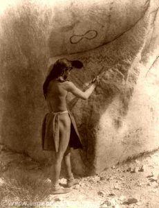 Paviotso Paiute making petroglyphs, 1924 by Edward S. Curtis