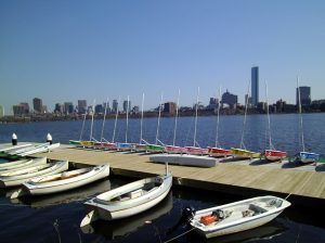 Sailboats in front of Boston skyline