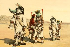 Men dressed in Kachina costumes