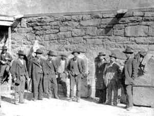 J.J. Webb, shackled in the center of the photo, next to his jailers at the Old Town Jail in Las Vegas, New Mexico.