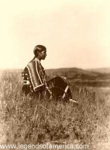 Piegan woman seated on the hill, 1910, Edward S. Curtis