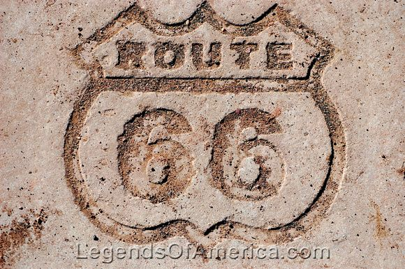 A Route 66 shield is carved in rock to commemorate where the Mother Road once ran through the the Petrified Forest National Park in Arizona. Photo by Dave Alexander.