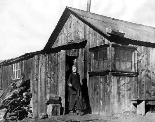 Baby Doe at her cabin in October, 1933, courtesy Denver Public Library.