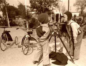 Children inspecting camera, 1942