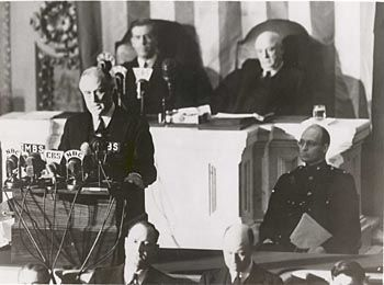 President Franklin D. Roosevelt delivers his famous Infamy Speech to Congress, one day after Japan attacked Pearl Harbor, December 7, 1941.
