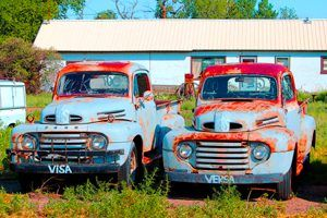 A couple of old trucks in Nara Visa, made a bit more colorful with a little enhancement