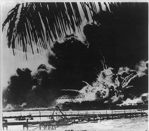 Pearl Harbor naval base and U.S.S. Shaw after the attack, Dec 7, 1941.