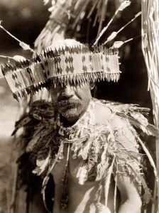 Pomo Indian in head dress.
