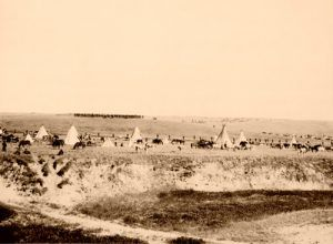 U.S. Troops surrounded the battlefield at Wounded Knee, re-enactment photo by James A. Miller, 1913.