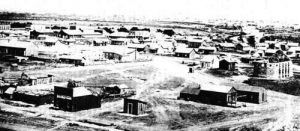 San Angelo, Texas in the foreground and Fort Concho in the background, 1886