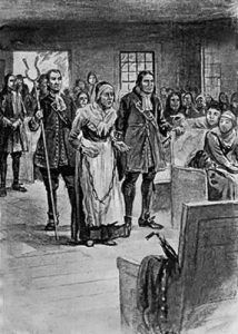 The elderly Rebecca Nurse is brought to the Salem Village Meeting House