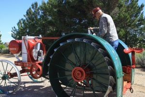 Buddie Knutson stands on his vintage Galloway Tractor. Photo by Jim Hinckley.