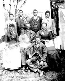 Former slave Nancy Gooch bought her son, Andrew Monroe, seated with a child on his lap at center, and his family out of slavery and brought them to her farm in Coloma.  Photo courtesy the El Dorado County Historical Museum