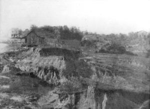 In this historic view of Rocky Springs, you can see several buildings in the background.