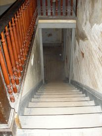 A floating orb appears at the bottom of this well-lighted stairwell, July, 2008