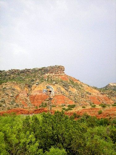 This view of Palo Duro Canyon shows a remnant windmill  from its days as a cattle ranch