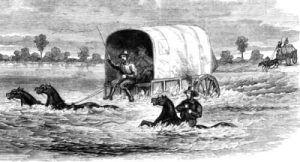 Wagon crossing a river