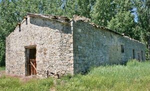 Stone warehouse on the PN Ranch, Montana courtesy American Prairie Reserve
