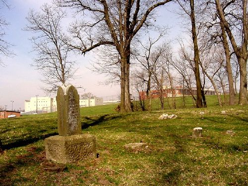 Glore Asylum Cemetery with a view of prison (old asylum) in the background, April 2005, Kathy Weiser.
